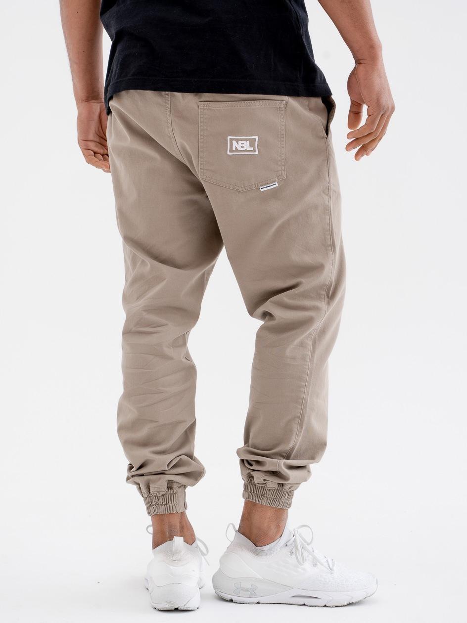 Spodnie Materiałowe Chino Jogger Ze Ściągaczem New Bad Line Icon Beżowe